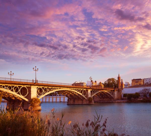 puente-isabel-ii-puente-atardecer-triana-sevilla_79295-14698